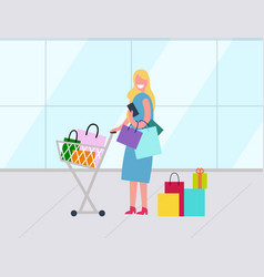 woman with shopping bags and supermarket trolley vector image