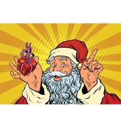 Santa Claus with gift box vector image vector image