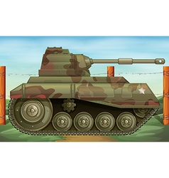 An armoured tank at the battlefield vector image