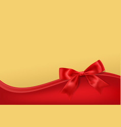 Golden stary background with red bow decoration vector