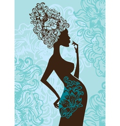 silhouette of pregnant woman in flowers vector image