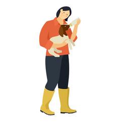 Farming today a woman bottle feeding a baby boer vector
