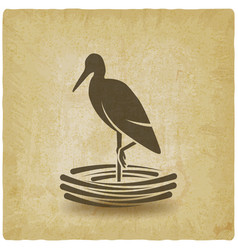 Stork stands on one leg in nest vintage background vector