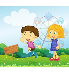 A boy and a girl playing near an empty signboard vector image