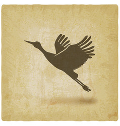 silhouette taking flight stork on vintage vector image