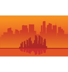 Silhouette of city with orange background vector image
