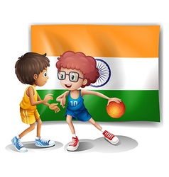 Two boys playing basketball in front of the Indian vector