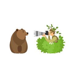 Wild animal photographer shooting grizzly bear vector