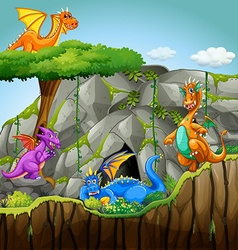 Dragons living in the cave vector
