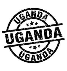 Uganda black round grunge stamp vector
