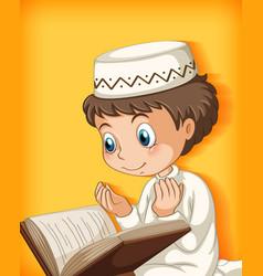 Muslim boy reading from quran vector