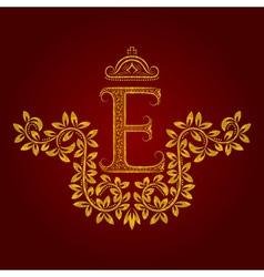 Patterned golden letter E monogram in vintage vector image vector image