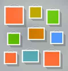 Blank color picture frame set on blured background vector