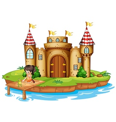 A girl sitting with a frog in front of a castle vector image