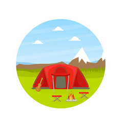 Red tourist tent and campfire on natural mountain vector