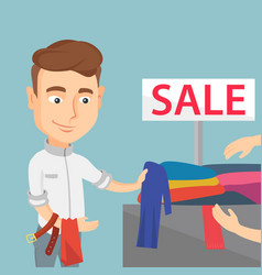 Young man choosing clothes in a shop on sale vector