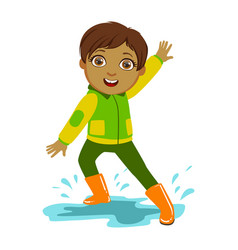 boy in green and yellow jacket kid in autumn vector image vector image