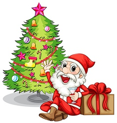 A happy Santa near the christmas tree vector image