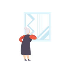 Elderly woman looking at the picture hanging on vector