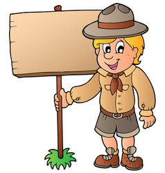 Scout boy holding wooden board vector