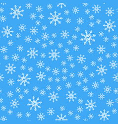 seamless pattern white snowflakes on a blue vector image