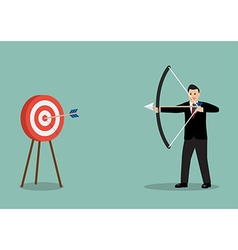 Businessman hitting the target vector image vector image