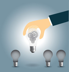 hand keep up idea concept with gear in light bulb vector image