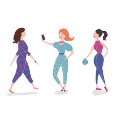 group of fashionable girls walking and posing vector image