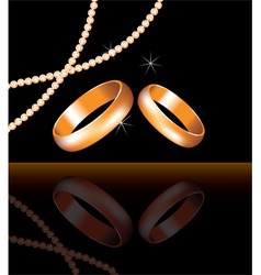 vector golden wedding rings and pearl beads vector image vector image
