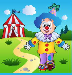 smiling clown with circus tent vector image