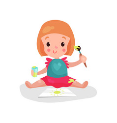sweet redhead little girl sitting on the floor vector image