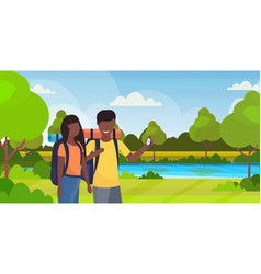 couple tourists hikers using compass searching vector image