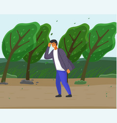 guy walking along country road strong gusts vector image