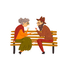senior man and woman playing cards while sitting vector image