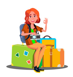 happy girl sitting on pile of suitcases ready to vector image