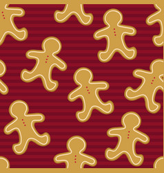 seamless pattern of gingerbread men on a red vector image