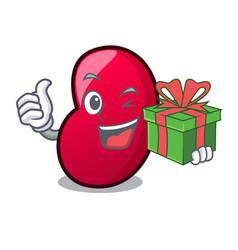 With gift jelly bean mascot cartoon vector