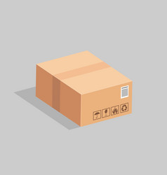 The sealed cardboard box on a gray background vector