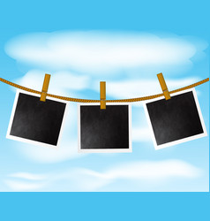 set of blank photo frames hanging on the rope with vector image
