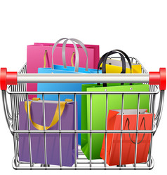 Supermarket cart with shopping bags vector