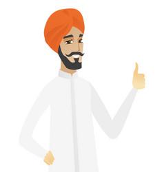 Young hindu businessman giving thumb up vector