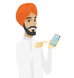 Hindu businessman holding mobile phone vector