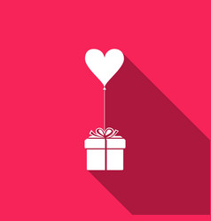 gift with balloon in shape of heart vector image