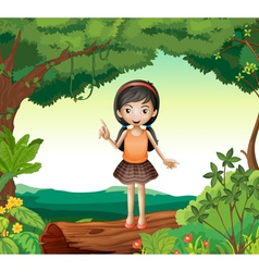 A girl standing on wood in nature vector image