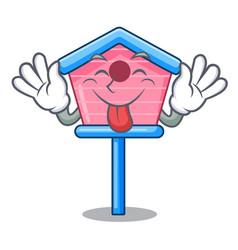 Tongue out bird house on a tree cartoon vector