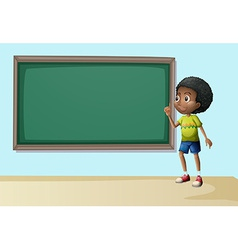 A boy near the empty blackboard vector image