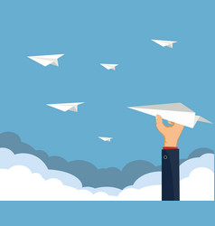 human hand holds a paper airplane vector image