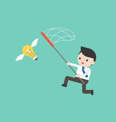 Businessman try to catch flying idea bulb with a vector