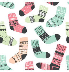 Seamless pattern with cute colorful socks vector