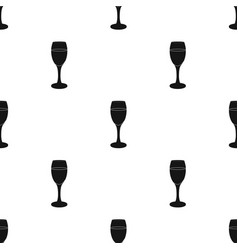 Glass of white wine icon in black style isolated vector